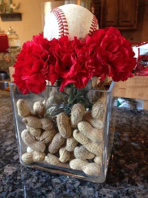 Kamille - Is this what you were thinking of with the peanuts? This looks pretty crummy but I like that we could bring in some white carnations for a feminine touch and gamma phi with a baseball on top. Maybe rough up some balls a little bit so they don't look so new.