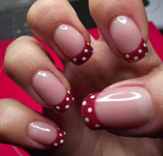 Red tips with white polka dots on french manicure.