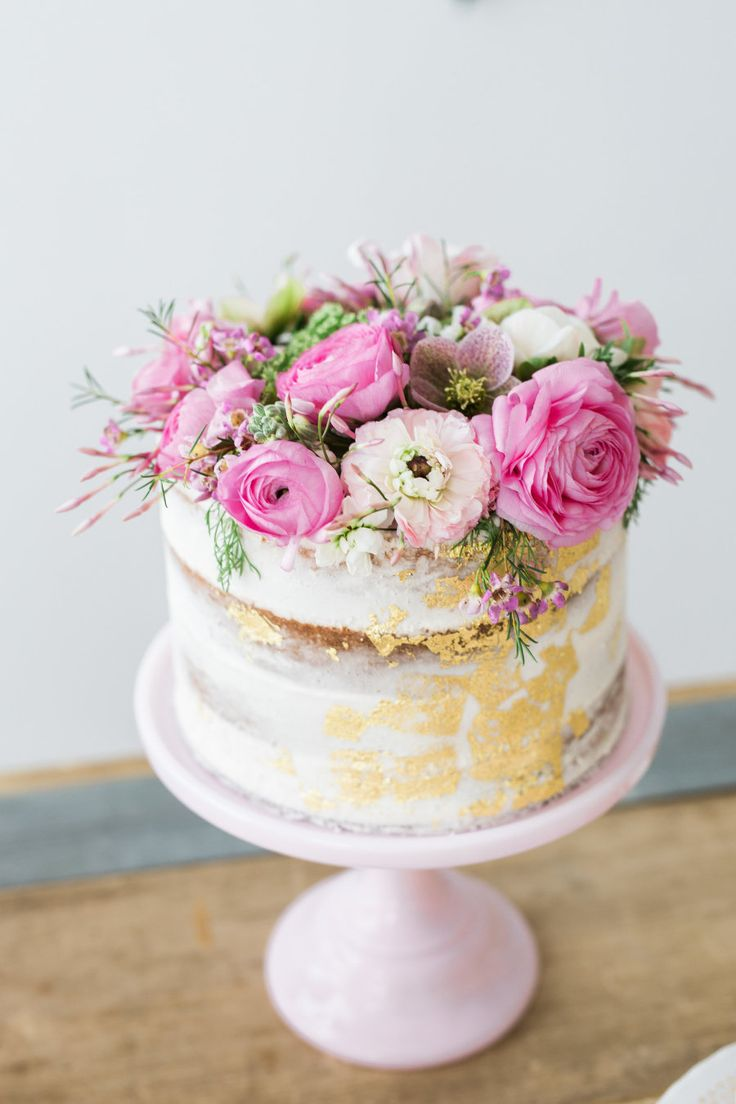 A gold brushed flower topped cake: http://www.stylemepretty.com/living/2016/04/07/a-bachelor-winner-throws-a-baby-shower-and-totally-nails-it/