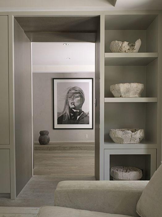 Beautiful built-in cubby shelves around door d