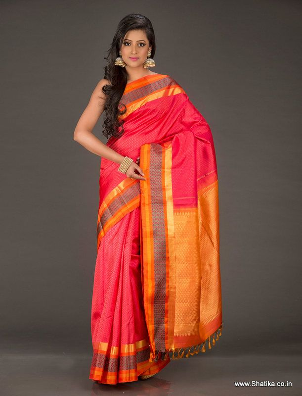 Damaruga priya Pretty Pink and Orange Pure Kanjivaram Silk Saree is for those of us for whom life is a celebration. Dunked in the colors of festivity and joy and crafted with goodness of silk and uprightness of pure silver zari, this Kanchipuram silk is your choice for all occasions for celebrations never end.