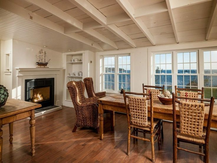 Daryl Hall has wood flooring, exposed beam ceiling, wood block dining table, woven chairs, open shelving, fireplaces and colonial tile windows.