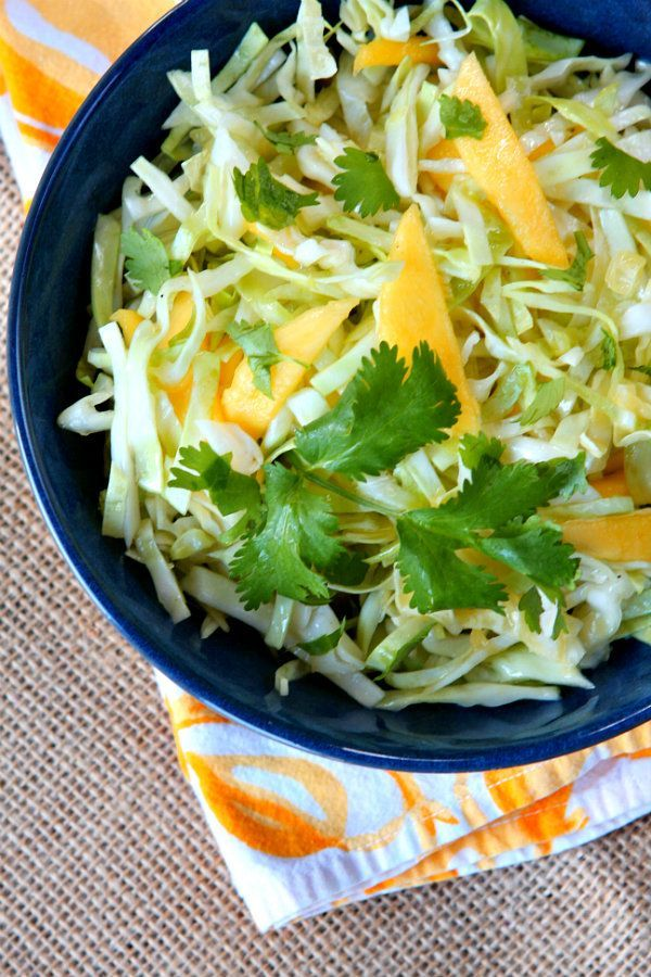 Easy, Delicious and Healthy Mango Slaw recipe from RecipeGirl.com : Nutritional information and Weight Watchers Points included.