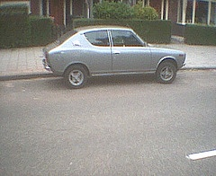 It's a Nissan ( Datsun) 100a , from the 70's picture is taken in 2007. rare one !