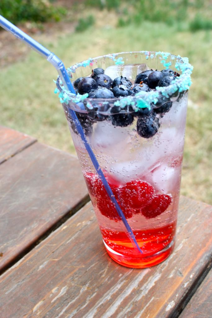 The Sparkler - a red white and blue cocktail rimmed with Pop Rocks - perfect cocktail recipe for the 4th of July!