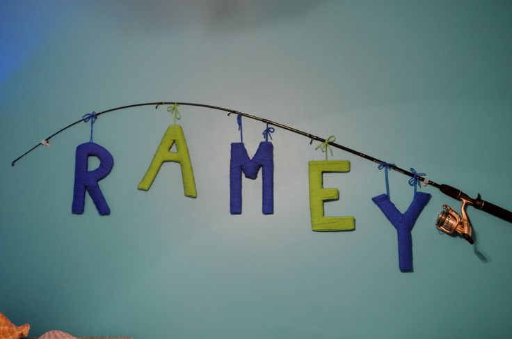 Yarn letter name on fishing pole, Baby nursery, fish nursery, baby boy nursery