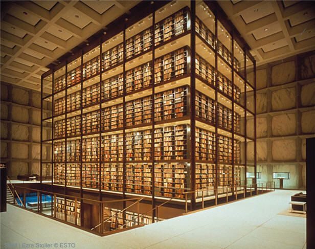 Beinecke Rare Book and Manuscript Library at Yale University. A tower of brass-bound glass holding treasures of the ages, encased in a shell of panels made of white Vermont marble which glow golden inwardly in sunshine and shine out like the moon after dark.