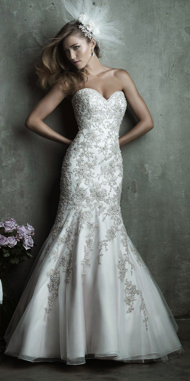 Allure Couture Spring 2014 Bridal Collection - Style C283. Dazzling Swarovski crystal embroidery adorns this strapless, slim-fitting wedding gown. A dramatic mermaid skirt leads to a beautiful organza and English net sweep train.