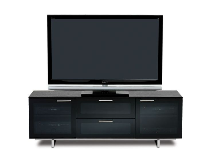 ... Media Cabinet And Television Stand Is Available In A Sleek Black  Finish, And Features Grey Tinted Glass Doors, An Integrated Center Channel  / Soundbar ...
