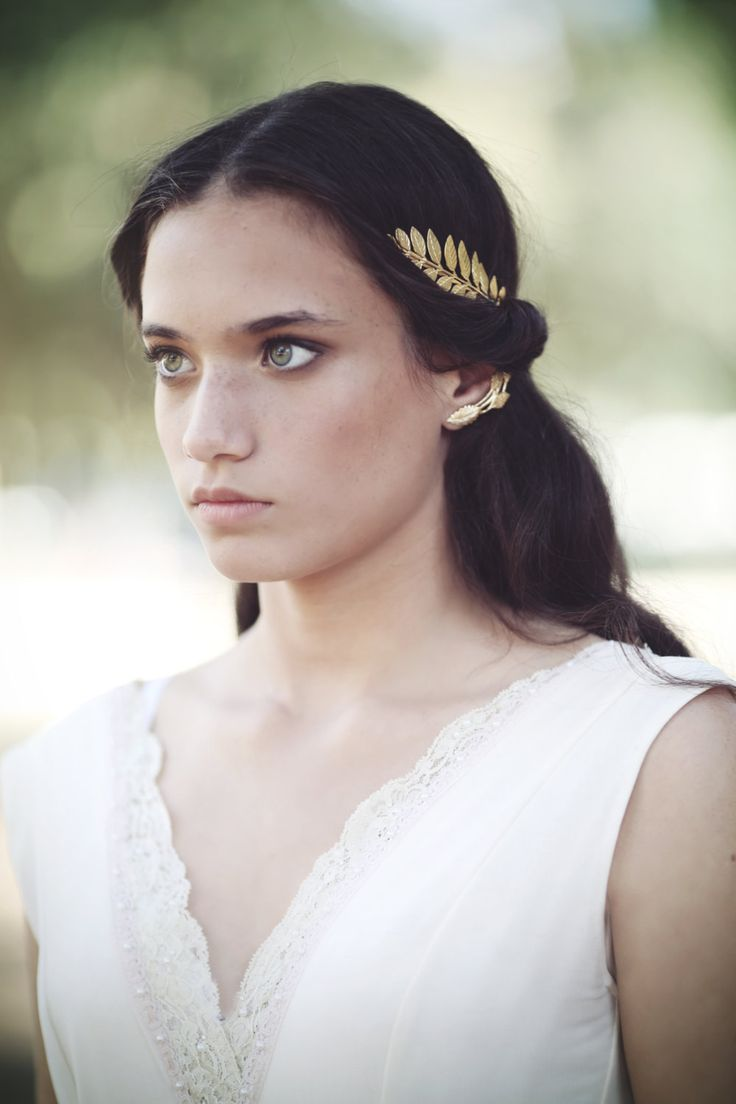 "This exquisite Greek goddess headband is almost the same as the loved and popular ""Athena"" crown, only it has a cute twist to it- the big greek leaf is sealed with two small leaves and a pearl instead"