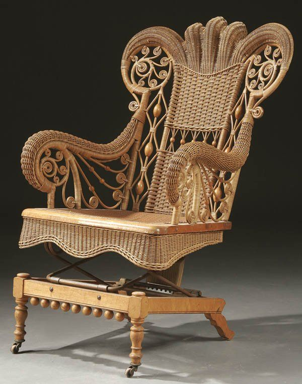 AN ELABORATE VICTORIAN WICKER ARMCHAIR ROCKER Wit