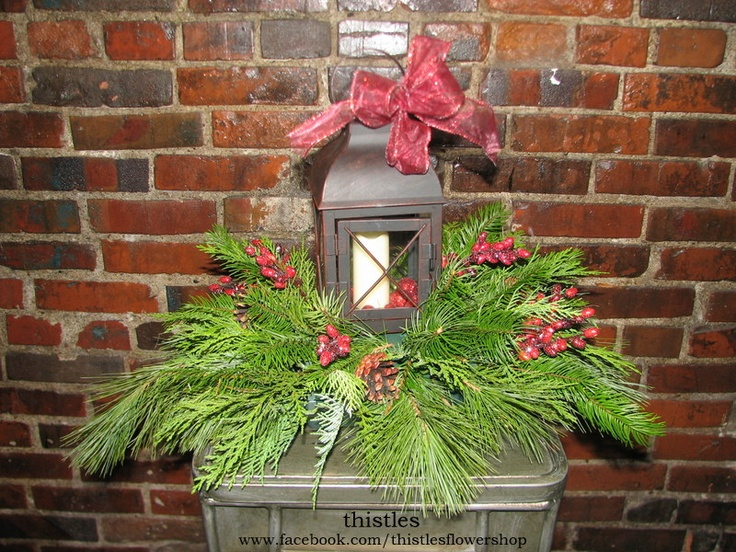 Evergreen centerpiece with a small lantern battery