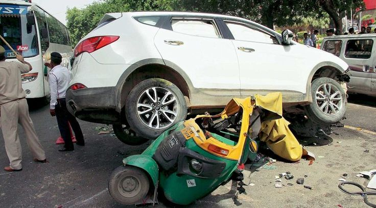 Gurgaon, India, July 15: SUV crashes into auto after shootout in Gurgaon, auto driver died on the spot at MG road on Wednesday morning, in Gurgaon, India, on Wednesday, July 15, 2015. Photo by Manoj Kumar