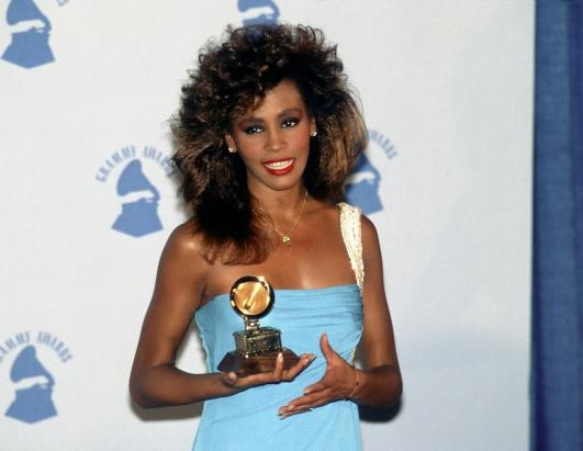 '80s hair or not, we love the flawless makeup and natural beauty of Whitney Houston