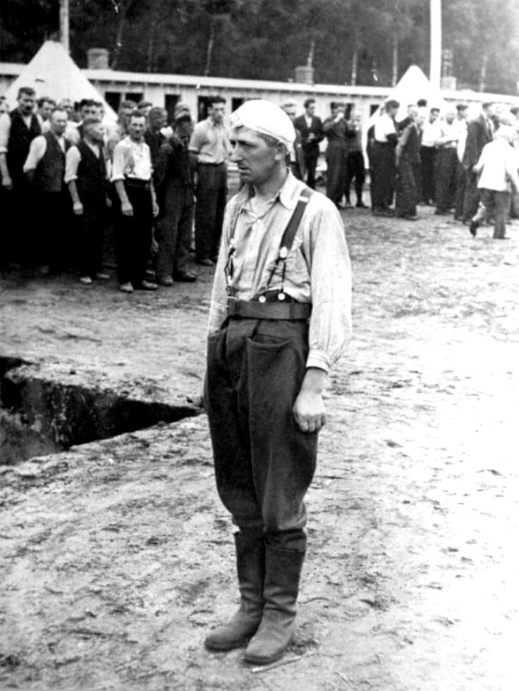 A Polish POW is singled out for punishment at the roll call area (Appellplatz) of Stutthof concentration camp. Stutthof was created directly following the German invasion of Poland. The camp was in operation from the day following the German invasion of Poland and was the last camp liberated by the Allies, on 9 May 1945. The first inmates imprisoned on 2 September 1939 were 150 Polish citizens, arrested on the streets of Danzig right after the outbreak of the war. The inmate population rose…