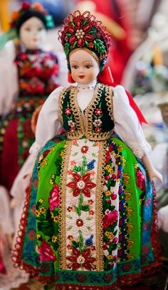 Dolls dressed in traditional Hungarian costumes... I used to play with little Hungarian dolls at my aunties house all the time.