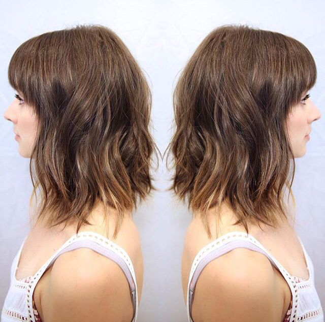 Shaggy collar bone length hair with fringe
