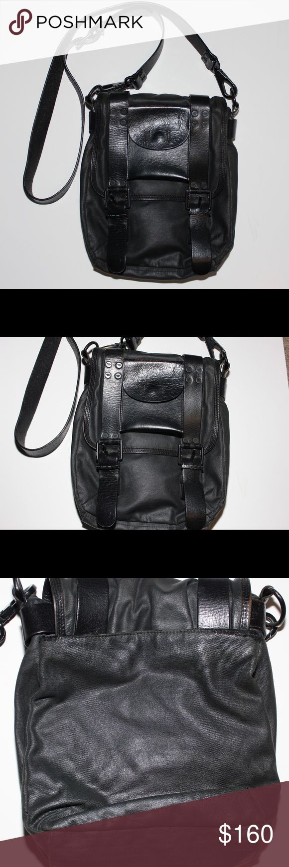 Diesel Unisex Convertible Crossbody Waist Bag So classic and badass! Cool looking thick distressed leather straps, coted canvas material, signature logo on hardware and inner lining, mild fraying on the edges is the back pouch, please see pics, you can in latch the strap fold it through the loop and reattach to wear it as a hands free fanny pack, perfect for concerts and festivals. Diesel Bags