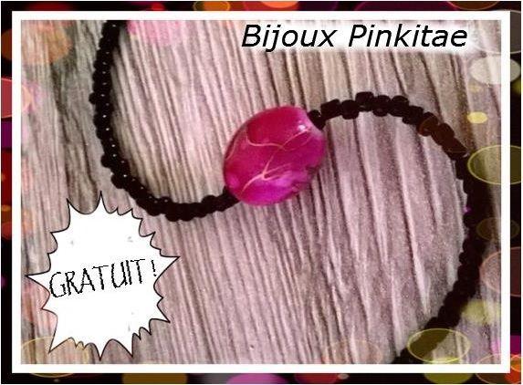 Bracelet perles noires avec une grosse perle framboise au milieu