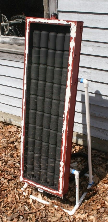 Garage Heater by Daniel Strohl -- Homemade garage heater constructed from surplus 2X4s and plywood, soda cans, plastic hose, and PVC. http://www.homemadetools.net/homemade-garage-heater