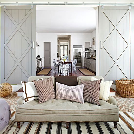 Barn Doors...Taking its inspiration from both farms and factories, these sliding doors are both practical and stylish. Simple track hardware eases installation and barn doors are fitting for several types of settings. Barn doors can be used for closets or to close off rooms joined together by a large doorway, such as this living room and dining room. Look for the hardware at farm supply stores.