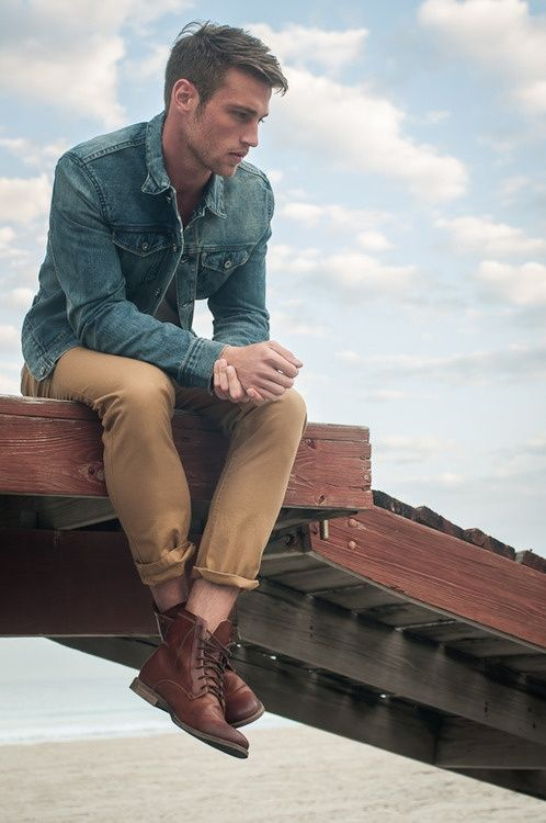 Shop this look for $150:  http://lookastic.com/men/looks/brown-leather-boots-and-tan-chinos-and-blue-denim-jacket/376  — Brown Leather Boots  — Khaki Chinos  — Blue Denim Jacket