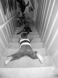 Sliding down the stairs on your tummy ~ carpets burns and sore ribs!