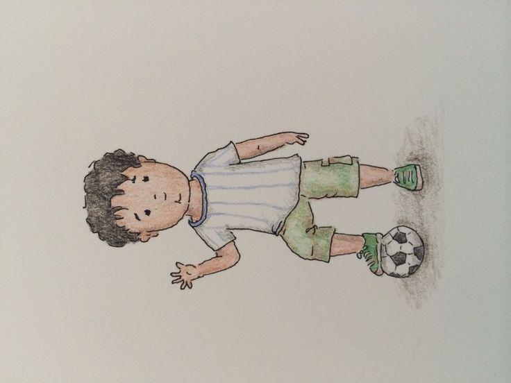 Little football (or soccer) player Oscar Tomas