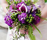 Purple and Green Wedding Bouquet  Bouquet Recipe:  3 Dark purple hydrangeas  3 Baby green hydrangeas  5 Purple dahlias  5 Purple stock  8 Picasso calla lilies  10 Purple freesia  3-5 Pink jasmine  5-7 Green hypericum berries  7-9 Sword fern fronds