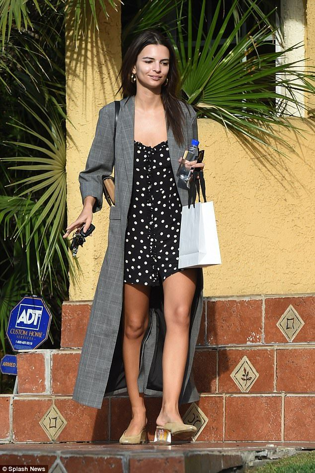 Style maven: Not afraid to clash patterns, she teamed it with a checked duster coat, looking in good spirits as she continued her daily errands