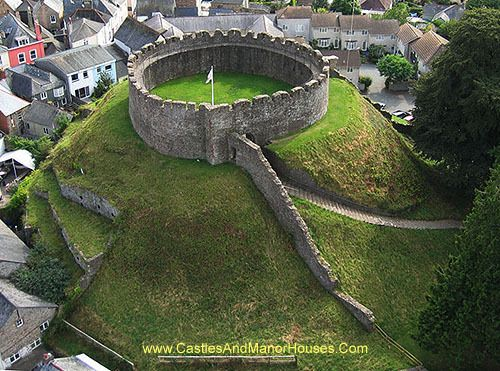 """Totnes Castle, Castle Street, Totnes, Devon TQ9 5NU, England... www.castlesandmanorhouses.com ... The castle occupies a commanding position on top of a hill above the town, and guards the approach to three valleys, including that of the River Dart. The surviving stone keep and curtain wall date from around the 14th century. Totnes Castle is one of the best preserved examples of a Norman motte (as in """"motte and bailey"""" castle) in England."""