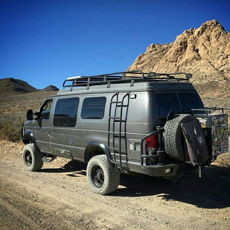 Sportsmobile with Aluminess roof rack, bumpers, and ladder