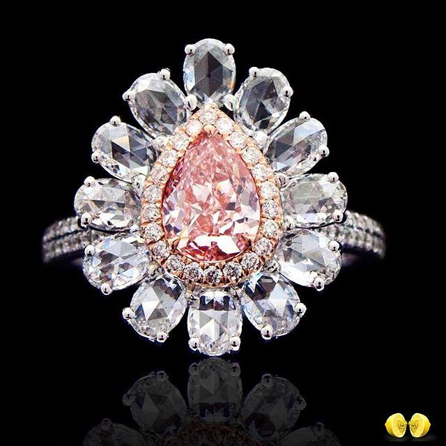 Novel Collection Asia. Rare and beautiful, this fancy orangish pink drop is placed in a halo of rose cut diamonds.