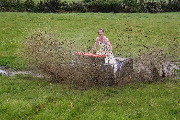 Motorbike & mud puddle. Trash my wedding dress.