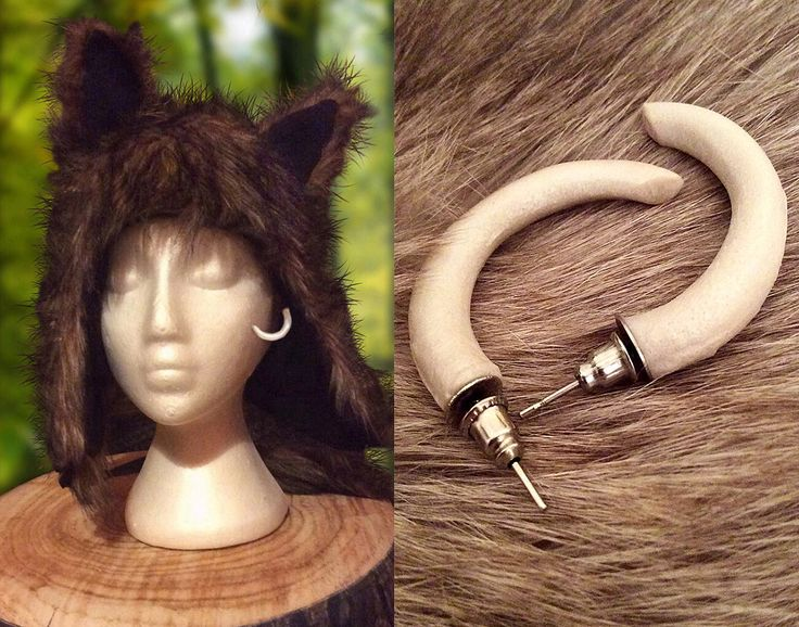 'Zaja Tusk Earrings' -- Tusk shaped wilderness earrings handmade from pearl colored resin. Inspired by the movie Captain Fantastic (2016)