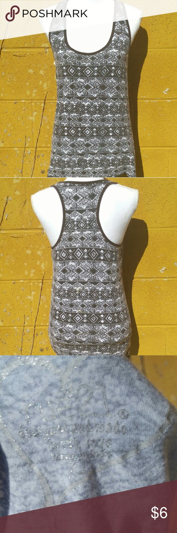 """Rue 21 racer back BRAND: Rue 21  SIZE: X-Large  FLAW: None  COLOR: Black, white and grey  DESCRIPTION: Black white and gray tribal print racerback/razorback tank top.  The mannequin measurements are:  Shoulders: 15"""" Chest: 34"""" Waist: 26.7"""" Hip: 35.4""""  Use #bishoujo to sort for your size. Please note I do have several pets, but all items will be washed before shipping  #rue21 #rue21tank #rue21shirt #racerback #racerbacktank #razorback #razorbacktank #tribalprint #tribal Rue21 Tops Tank Tops"""