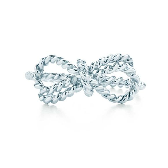 Authentic Tiffany twist bow ring Sterling Silver AUTHENTIC Tiffany twist bow ring. Fairly new. Comes with dust bag. No scratches or dents. Tiffany & Co. Jewelry Rings