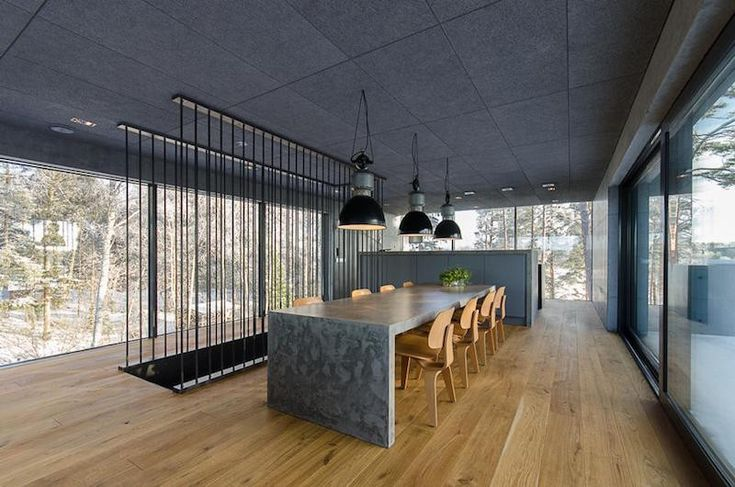 Located in the Turku Archipelago in Finland, this 230 square meters big concrete house rises up from the nature, adapting same time to the surrounding rocks and environment. The natural light flows in directly from the big windows around the house. Besides as a construction material the concrete is used widely in the furniture and other interior elements as well. The house gets its energy from the nature while the oak floor and acoustic ceiling panelling adds a warm cozy atmosphere. The…