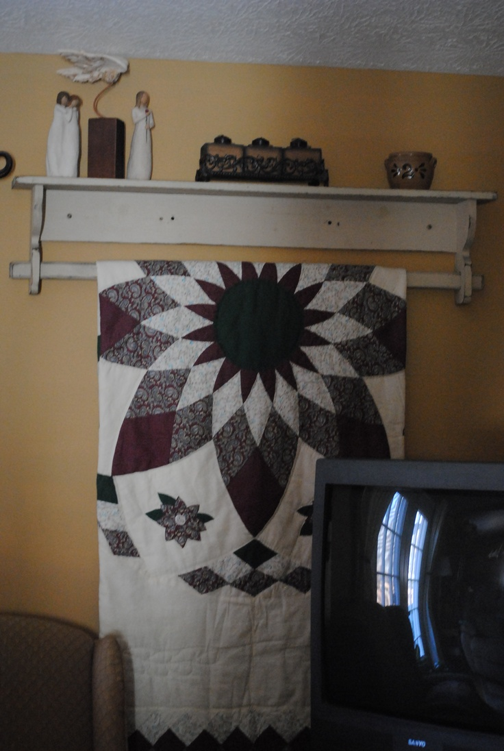 Quilt rack displaying a quilt which belonged to my mother. Love quilts!