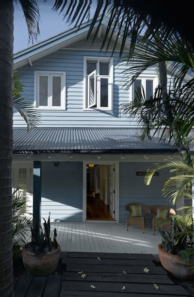 Blue and grey weatherboard home with first floor parents retreat addition, wrap-around deck