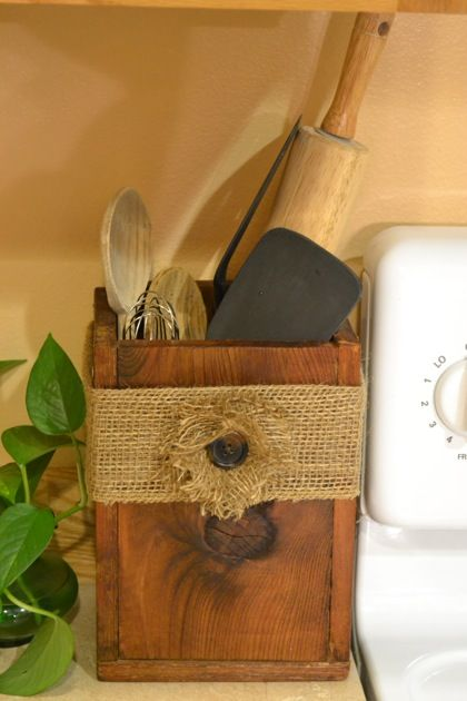 DIY Burlap Box-If you have a few small pieces of wood just lying around, you can make your own utensil box and decorate it however you want. This is a great way to keep mixing spoons and other things organized in the kitchen. You could also use it in a smaller version on your desk to keep pens and pencils organized. Just nail four pieces of wood together into a box and add a bottom.