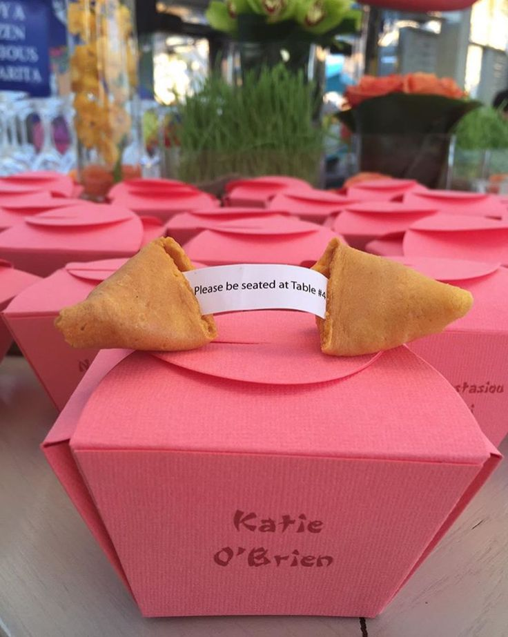 fortune cookie seating chards, break your cookie and get a fortune and your table number (custom boxes by @lehrandblack)