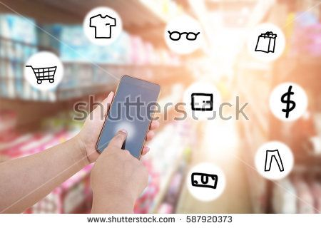women use mobile phone and blurred image of supermarket with icon hand drawing. shopping concept.