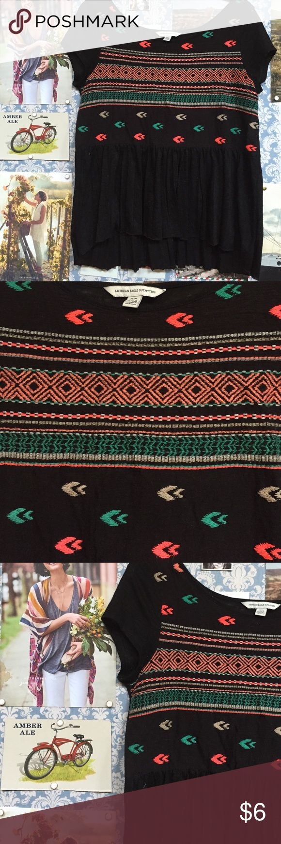 American Eagle Outfitters Aztec Top This American Eagle top feels like a t-shirt but has a flowy bottom half that almost feels like a little skirt! It has an adorable stitch work across the chest with a bright tribal design. American Eagle Outfitters Tops Blouses