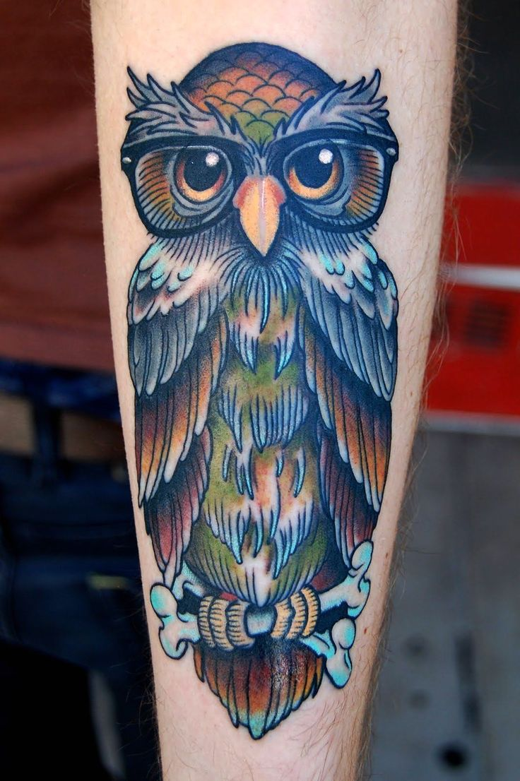 Magic owl watercolor tattoo on arm for woman
