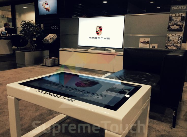 Customized #Corian #multitouch table for #Porsche waiting room. #SnowflakeSuite makes waiting fun and informative.