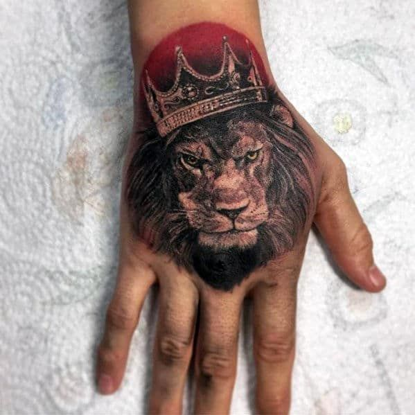 Lion With Crown Tattoo On Hand