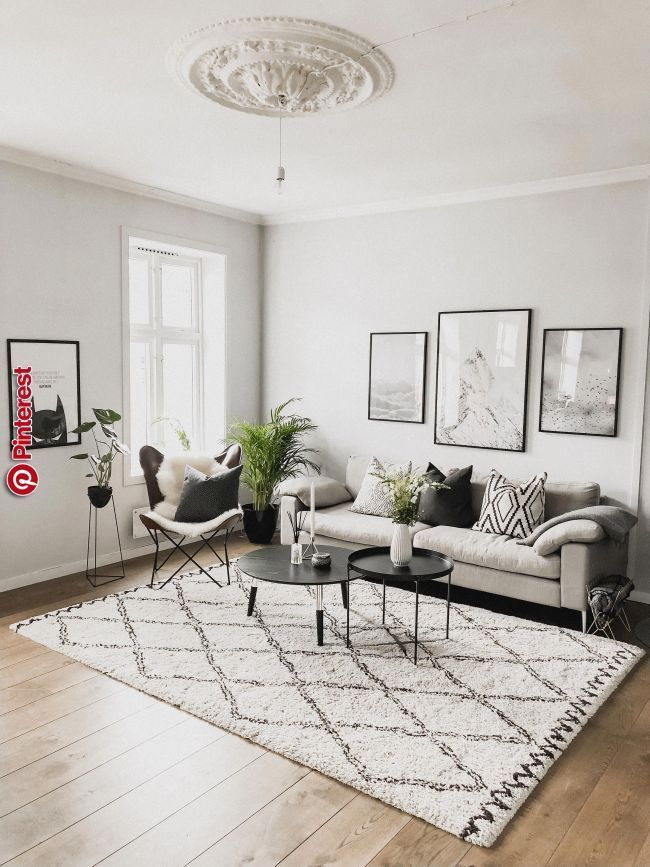 Spacious Living Room With A Leather Butterfly Chair An Oriental Rug A Beautiful Golden Chande Casual Living Room Decor Living Room Modern Living Room Designs