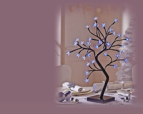 LED Blossom Tree £15 each These modern Christmas ornaments will add a touch of class to your decorations this festive season. Choose from blue or multi- coloured All blossom trees stand 45cm high and require 3 x AA batteries (not included).
