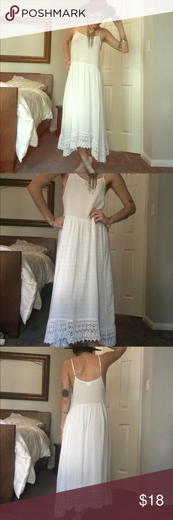 GORGEOUS SIMPLE FREE PEOPLE MAXI LACE SLIP DRESS White, classic, timeless, and versatile. Loved but in near perfect condition. Small microscopic discoloration at waist, which the price reflects. Semi-sheer but ok with nude undergarments. Can be dressed up or used as a slip but looks great by itself. Fits size xs- s best. Free People Dresses Maxi